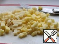 Peel potatoes and cut into small cubes.