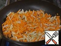 Add the carrots and celery and fry until soft.