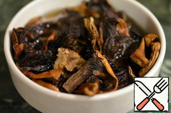 Wash the mushrooms and soak in hot water for an hour.