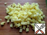 Chop the potatoes into small cubes.