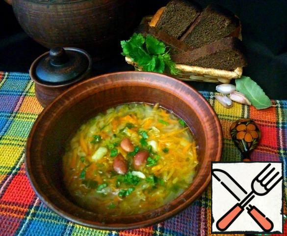 Serve the soup to the table. In a plate you can separately add the chopped herbs and crushed garlic.