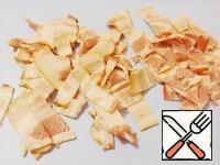 Bacon cut into small strips.