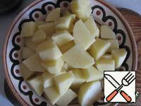 After 10 minutes add the sliced potatoes. Salt, pepper to taste.