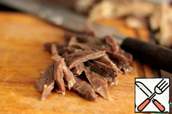 Boiled beef is cut into small pieces.
