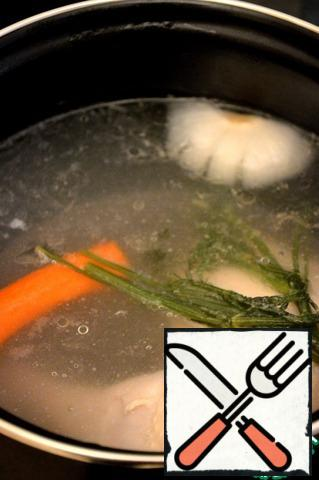 Boil the chicken in water, add a small carrot, a piece of onion, and  herbs.