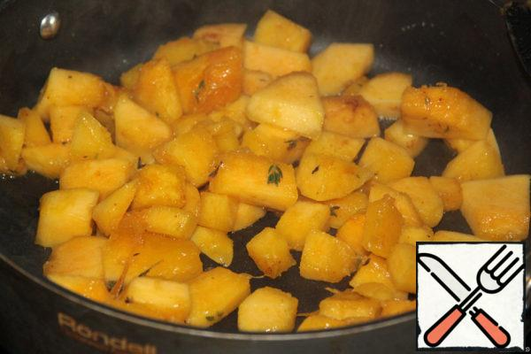 The rest of the pumpkin cut into cubes and fry in olive oil with cumin.