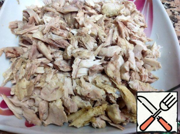 Chicken meat separated from the bones and cut into small pieces.