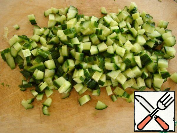 Chop the cucumber into cubes.