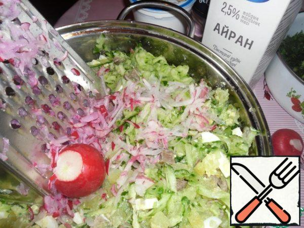 You can optionally add grated on a coarse grater radish. But you can do without it.