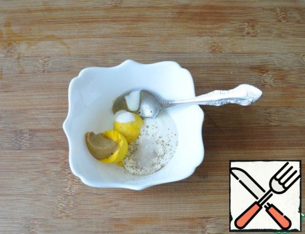 Egg clean, the yolk rubbed with mustard, sour cream, salt and black pepper