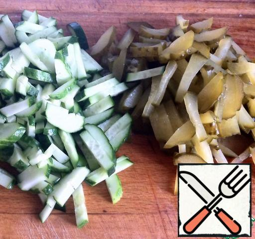 Pickled and fresh cucumbers cut into strips.