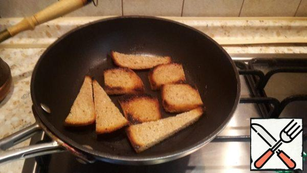 Fry the bread in butter.