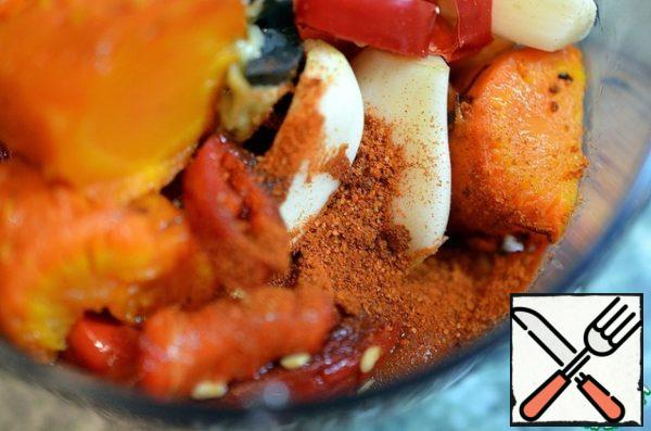 In the bowl of a blender combine chopped tomatoes, peppers (all without skin), garlic (optional) and paprika.
