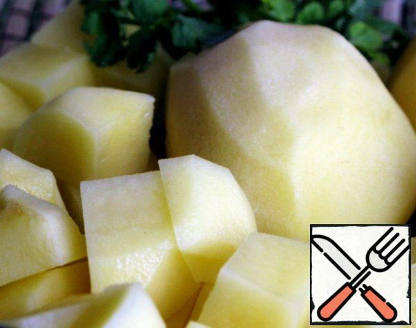 Potatoes cut into cubes. Put in boiling water or broth.