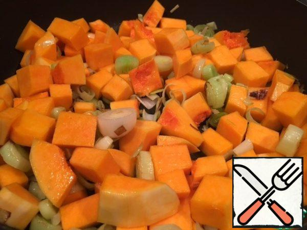 Clean and cut the pumpkin into small pieces. Add to onion.
