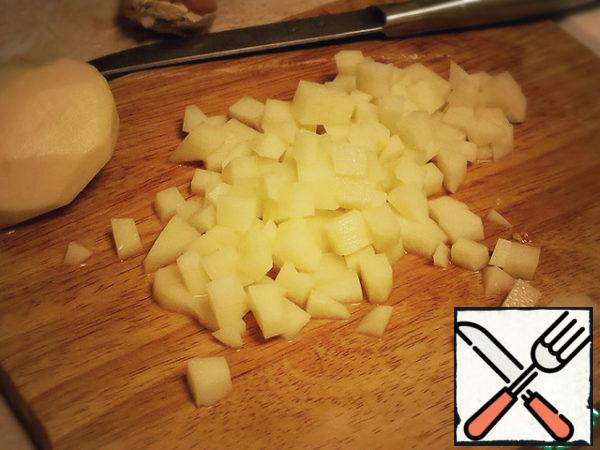 Rinse salt from eggplant. Cut into cubes eggplant and potatoes.