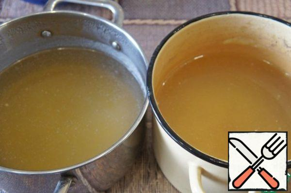 Cook beef and chicken broth from the bones, strain. 1/4 Cup beef broth will left to cook meatballs.