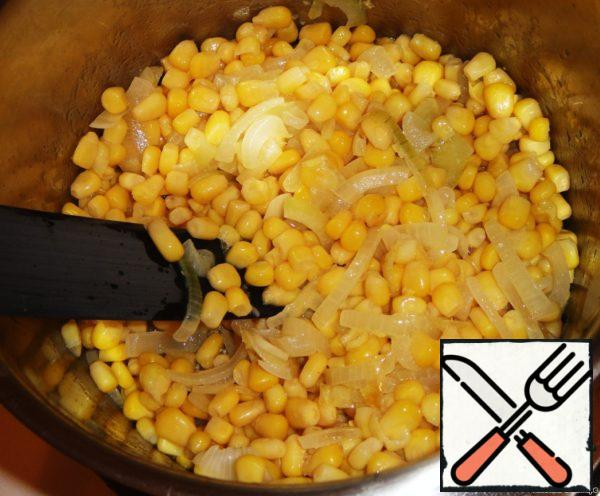 Once the onions have become translucent, add corn and fry all together 5-7 minutes. The liquid from the jar of corn should be drained into a separate bowl (you will need it later).
