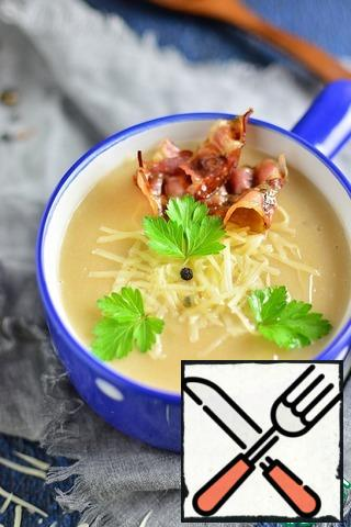 Pour soup into a plate, add crispy bacon, grated cheese and herbs.
