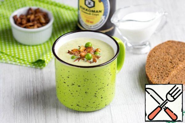 Grind the soup in a blender until smooth, enter cream. Back on the stove and bring to a boil, stirring constantly. Serve in a plate or mug, adding a crispy onion.