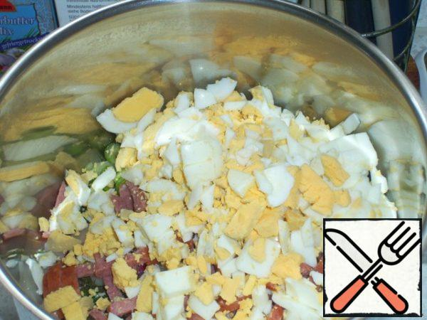 Now eggs clean, cut and put in a pot.
