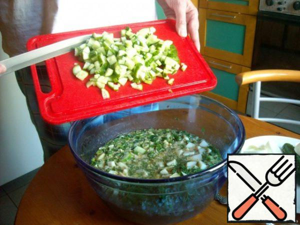Add cucumbers. Protein from the eggs cut and add  to the same.