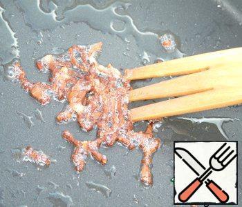 Bacon cut into thin slices. Fry until crispy crust.