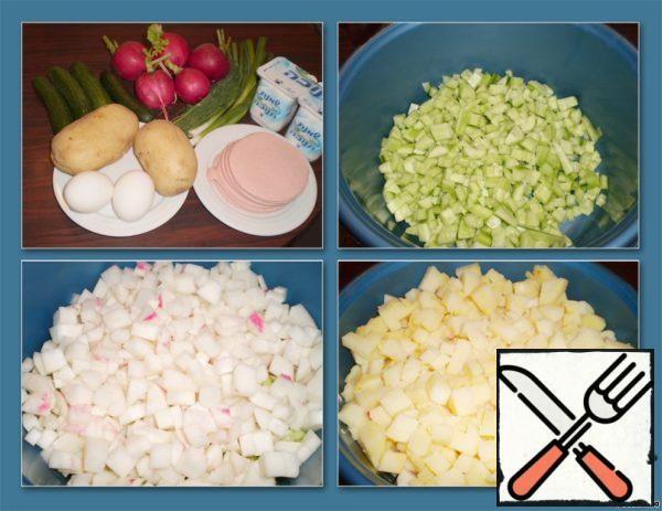 Prepare the ingredients for okroshka. Pour water into the pot, boil it. Cucumbers, boiled potatoes and radishes, peel and finely chop.