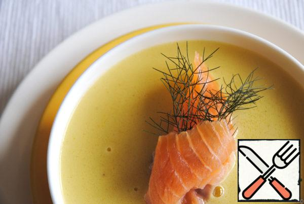 Serve soup in plates or cups, each put a piece of salmon and a branch of fennel or dill.
