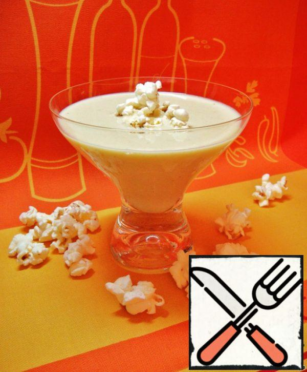 Hot soup poured into cups or bowls. And served with popcorn, which will added directly into the soup like croutons.