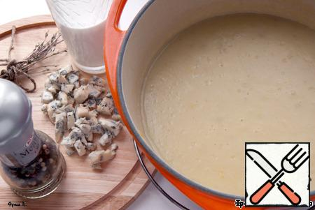 From soup to remove bay leaf and cumin, shake a blender until homogeneity. Pour the cream, add half of cheese and salt to taste, blend again. Heat the soup and remove from heat. Before serving, garnish with remaining cheese and herbs.