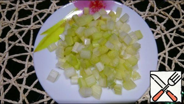Celery is cut into small cubes and add into the broth.