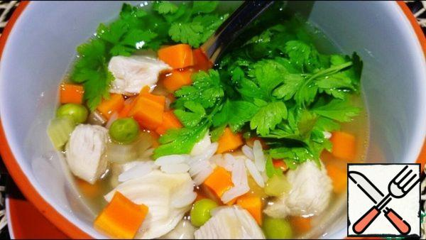 Before serving, chicken fillets and parsley are added to the soup.