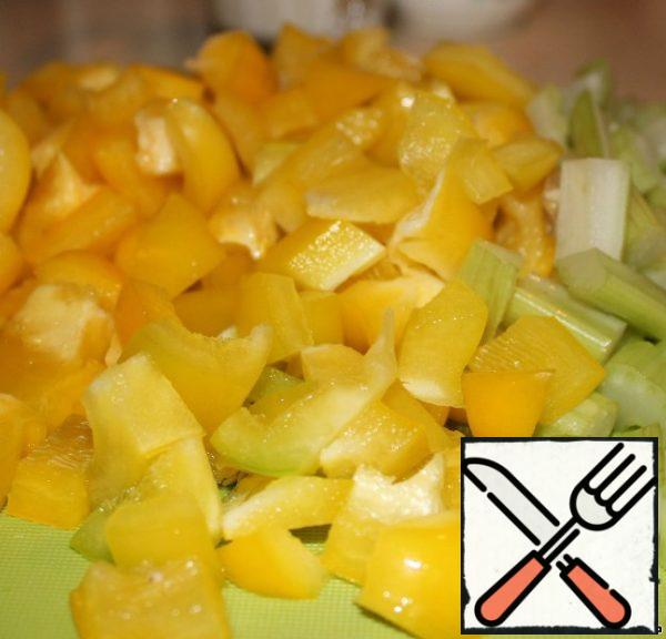 Pepper and celery cut into small cubes-squares.