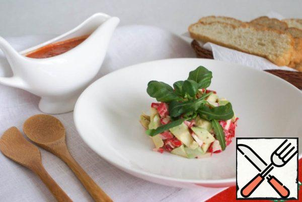 Using a serving ring put the salad in the middle of the plate and decorate the top with herbs. As such, the salad is served on the table along with a chilled soup.