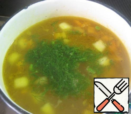 Add chopped greens of dill and parsley. Turn off and give the soup a little brew.