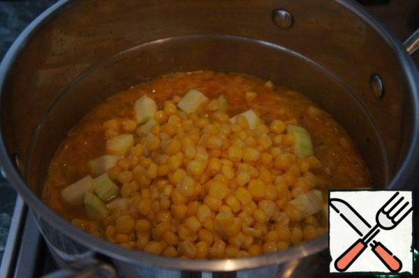 Then add squash and corn (3-4 tbsp reserved for garnish) together with the liquid. Bring to a boil and cook over low heat until the vegetables are tender.