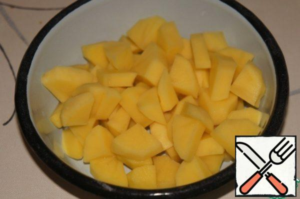 Potatoes cut into cubes or slices.