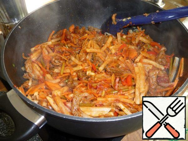 Add garlic arrows, pickled peppers, jusay, tomato paste, overcook.