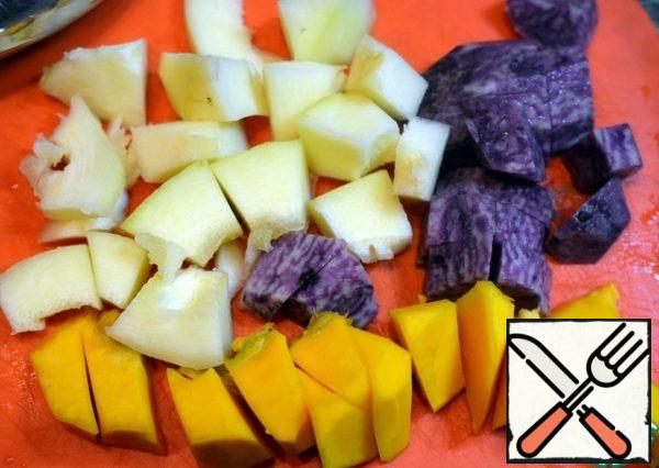 Peel the vegetables and cut into cubes. I have purple potatoes.