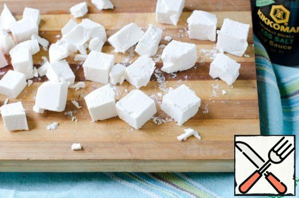 Cheese feta cut into cubes.