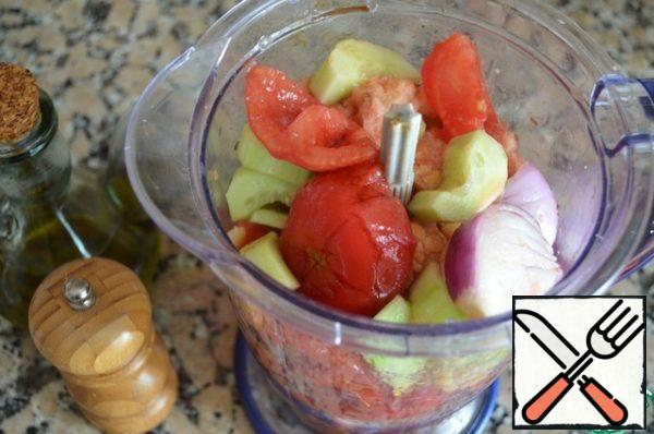 Put half of all vegetables, bread, olive oil, vinegar, and tomato juice in a food processor or blender, add salt and freshly ground black pepper, and grind everything to a smooth, thick soup. Repeat with remaining ingredients. Pour the soup into a saucepan and put in the refrigerator to cool for about 2 hours.
