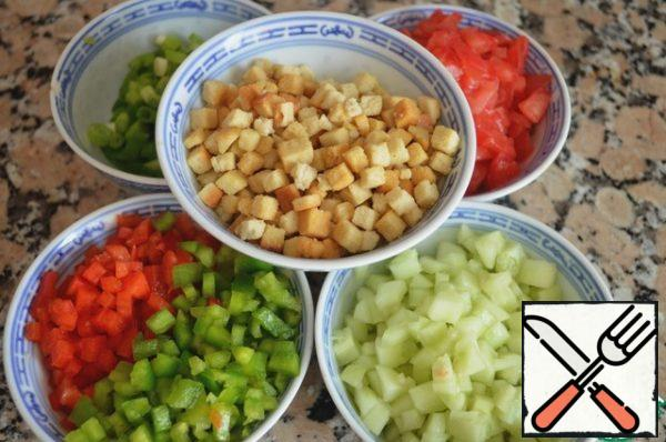 Peel the vegetables for the side dish and cut them into small cubes.