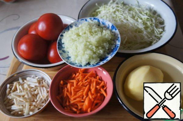 Carrots and celery cut into strips, onion and crush the garlic. Cabbage finely chopped.
