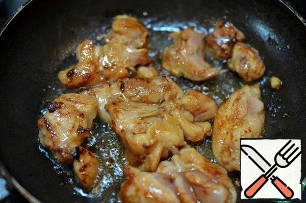 Put in a separate bowl. In the same pan fry the chicken in portions until Golden brown. Then place in a separate bowl.