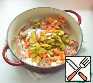 Add chopped onions, carrots and pickles. Cook for about 3-5 minutes.
