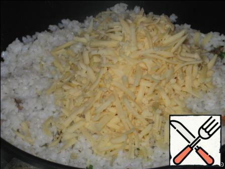 Cheese three on a grater and spread in a frying pan. Wait for it to melt.
