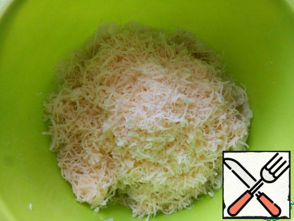 Add the egg, flour, butter, cheese, crushed herbs and cheese grated on a fine grater.