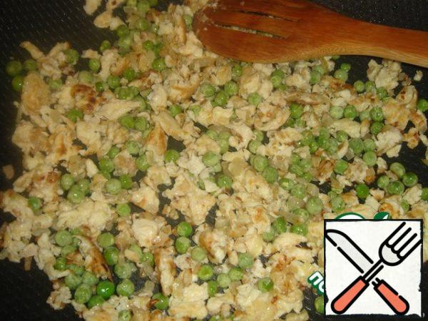 Add the frozen peas to the omelet and heat for a few minutes.