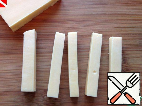 Cheese cut into long bars.